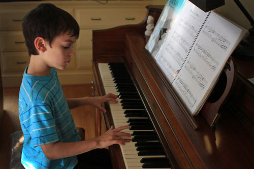 child+playing+piano